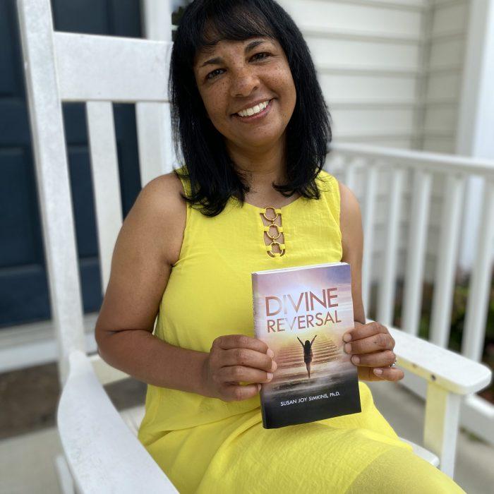Susan Joy Simkins holding Divine Reversal
